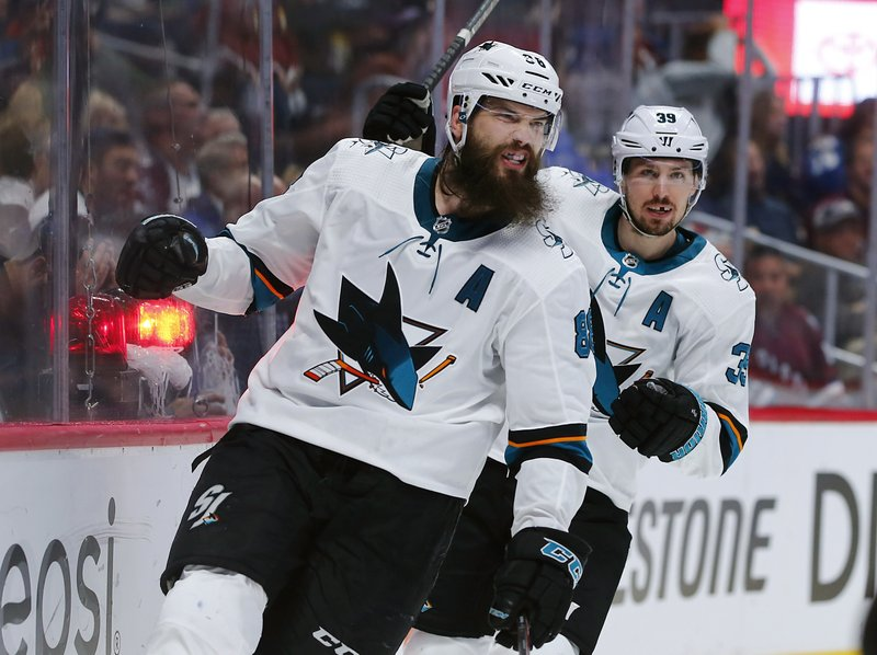 San Jose Sharks defenseman Brent Burns, front, reacts after scoring a goal as center Logan Couture follows in the second period of Game 6 of an NHL hockey second-round playoff series against the Colorado Avalanche, Monday, May 6, 2019, in Denver. (AP Photo/Jack Dempsey)