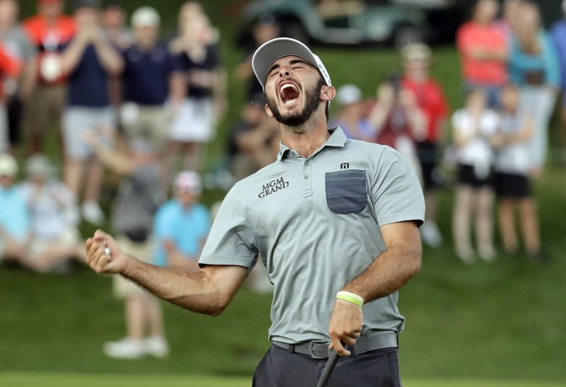 Max Homa celebrates after winning the Wells Fargo Championship golf tournament at Quail Hollow Club in Charlotte, N. (AP Photo/Chuck Burton)