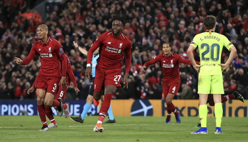 Liverpool's Divock Origi, center, celebrates scoring his side's fourth goal of the game during the Champions League Semi Final, second leg soccer match between Liverpool and Barcelona at Anfield, Liverpool, England, Tuesday, May 7, 2019. (Peter Byrne/PA via AP)