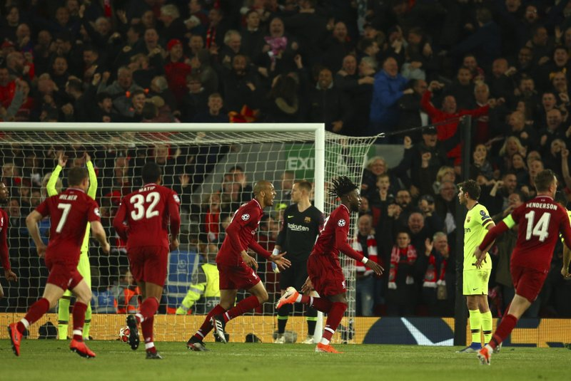 Liverpool's Divock Origi celebrates scoring his side's 4th goal during the Champions League semifinal, second leg, soccer match between Liverpool and FC Barcelona at the Anfield stadium in Liverpool, England, Tuesday, May 7, 2019. (AP Photo/Dave Thompson)