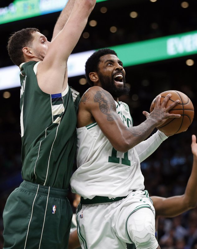 Boston Celtics' Kyrie Irving (11) shoots against Milwaukee Bucks' Nikola Mirotic during the second half of Game 4 of a second-round NBA basketball playoff series in Boston, Monday, May 6, 2019. (AP Photo/Michael Dwyer)