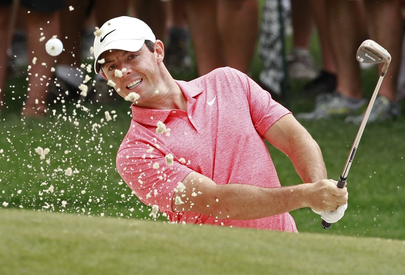 Rory McIlroy, of Northern Ireland, hits from a sand trap on the first hole during the final round of the Wells Fargo Championship golf tournament at Quail Hollow Club in Charlotte, N. (AP Photo/Jason E. Miczek)