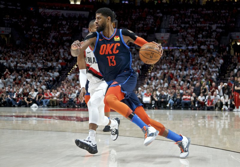 Oklahoma City Thunder forward Paul George, foreground, drives to the basket past Portland Trail Blazers guard Rodney Hood during the first half of Game 5 of an NBA basketball first-round playoff series, Tuesday, April 23, 2019, in Portland, Ore. (AP Photo/Craig Mitchelldyer)