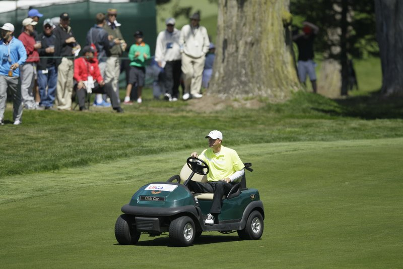 FILE - In this June 15, 2012, file photo, Casey Martin drives to the fifth green during the second round of the U. (AP Photo/Eric Risberg, File)