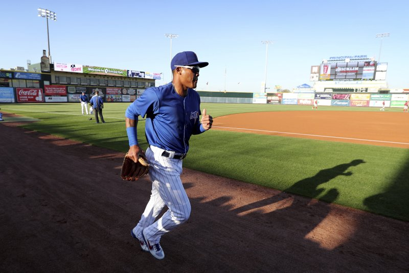 Iowa Cubs shortstop Addison Russell runs on the field before a Triple-A baseball game against the Nashville Sounds, Wednesday, April 24, 2019, in Des Moines, Iowa. (AP Photo/Charlie Neibergall)