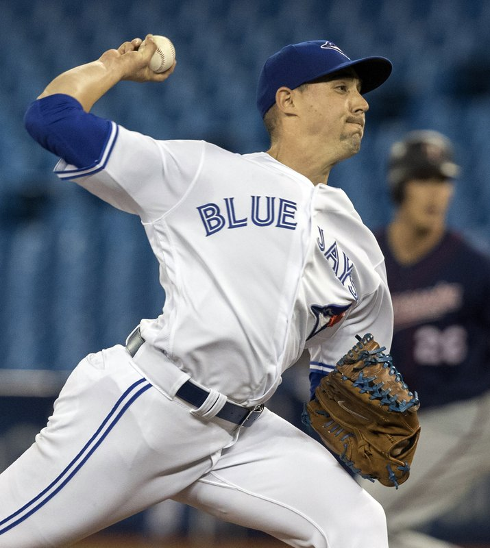 Toronto Blue Jays starting pitcher Aaron Sanchez throws against the Minnesota Twins during the first inning of a baseball game in Toronto, Tuesday, May 7, 2019. (Fred Thornhill/The Canadian Press via AP)