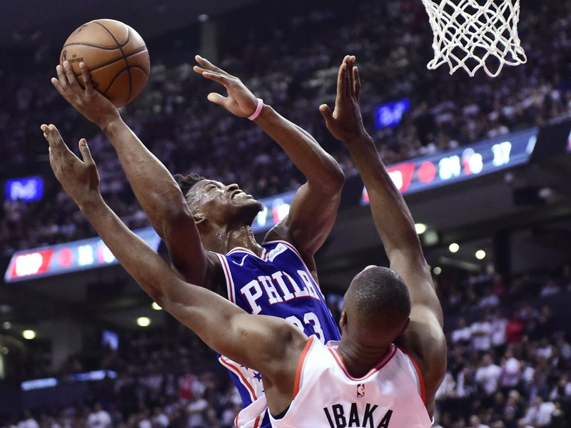 Philadelphia 76ers guard Jimmy Butler (23) shoots as Toronto Raptors centre Serge Ibaka (9) defends during the first half of Game 5 of an NBA basketball second-round playoff series, Tuesday, May 7, 2019, in Toronto. (Frank Gunn/The Canadian Press via AP)