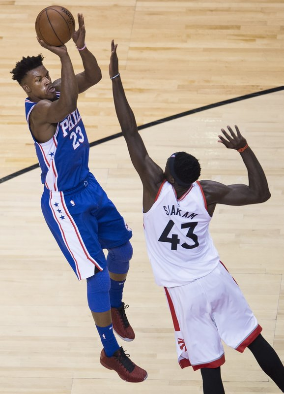 Philadelphia 76ers guard Jimmy Butler (23) tries for a jump shot against Toronto Raptors forward Pascal Siakam (43) during the second half of Game 5 of an NBA basketball second-round playoff series, Tuesday, May 7, 2019, in Toronto. (Nathan Denette/The Canadian Press via AP)