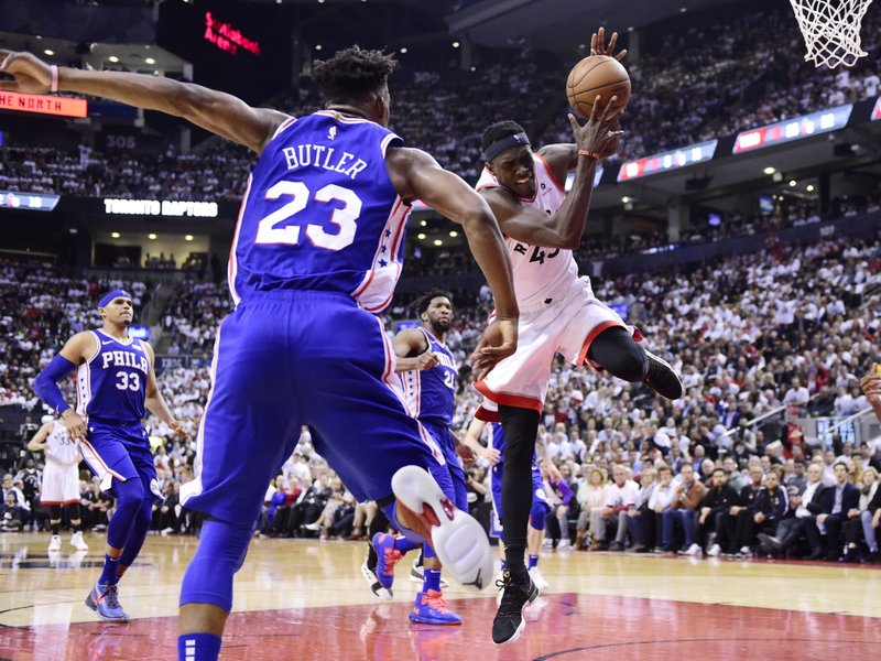 Toronto Raptors forward Pascal Siakam (43) is fouled by Philadelphia 76ers guard Jimmy Butler (23) during the second half of Game 5 of an NBA basketball second-round playoff series, Tuesday, May 7, 2019, in Toronto. (Frank Gunn/The Canadian Press via AP)