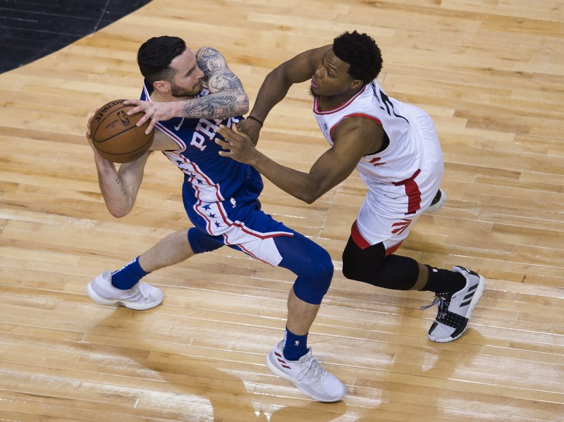 Philadelphia 76ers guard JJ Redick keeps the ball from Toronto Raptors guard Kyle Lowry during the second half of Game 5 of an NBA basketball second-round playoff series, Tuesday, May 7, 2019, in Toronto. (Nathan Denette/The Canadian Press via AP)