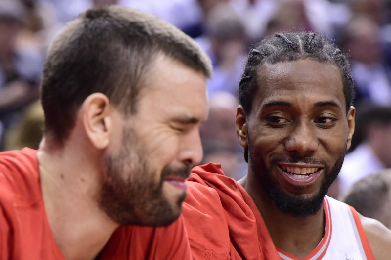 Toronto Raptors forward Kawhi Leonard, right, and center Marc Gasol smiles during the second half of Game 5 of the team's NBA basketball second-round playoff series against the Philadelphia 76ers, Tuesday, May 7, 2019, in Toronto. (Frank Gunn/The Canadian Press via AP)