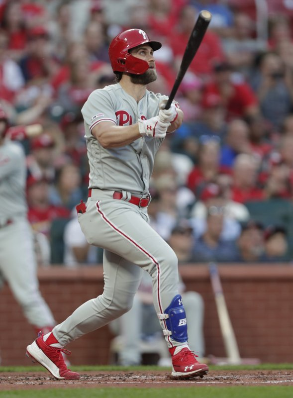 Philadelphia Phillies' Bryce Harper watches his grand slam during the second inning of the team's baseball game against the St. (AP Photo/Tom Gannam)