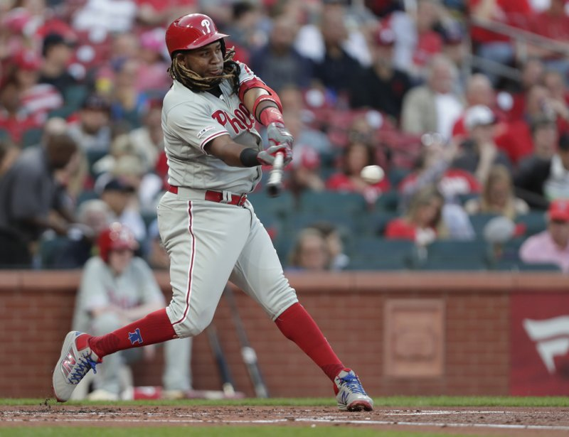 Philadelphia Phillies' Maikel Franco hits a grounder that drove in a run during the second inning of a baseball game against the St. (AP Photo/Tom Gannam)