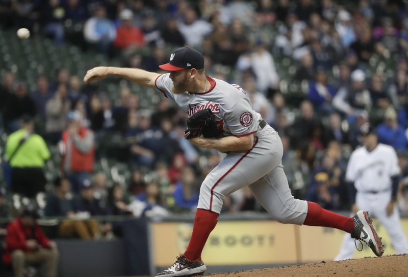 Washington Nationals starting pitcher Stephen Strasburg throws during the first inning of a baseball game against the Milwaukee Brewers Tuesday, May 7, 2019, in Milwaukee. (AP Photo/Morry Gash)