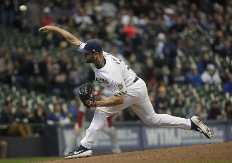 Milwaukee Brewers starting pitcher Adrian Houser throws during the first inning of a baseball game against the Washington Nationals Tuesday, May 7, 2019, in Milwaukee. (AP Photo/Morry Gash)