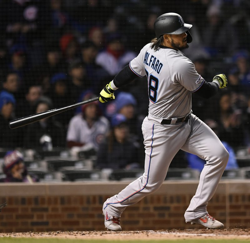 Miami Marlins' Jorge Alfaro watches his RBI-single during the third inning of a baseball game against the Chicago Cubs, Tuesday, May 7, 2019, in Chicago. (AP Photo/Paul Beaty)