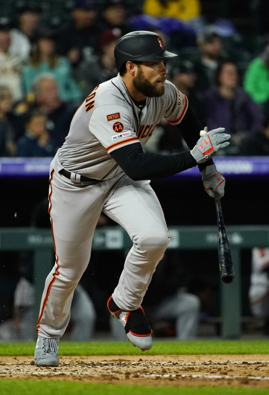 San Francisco Giants' Mac Williamson watches the flight of an RBI-single ball hit against the Colorado Rockies during the fifth inning of a baseball game, Tuesday, May 7, 2019, in Denver. (AP Photo/Jack Dempsey)