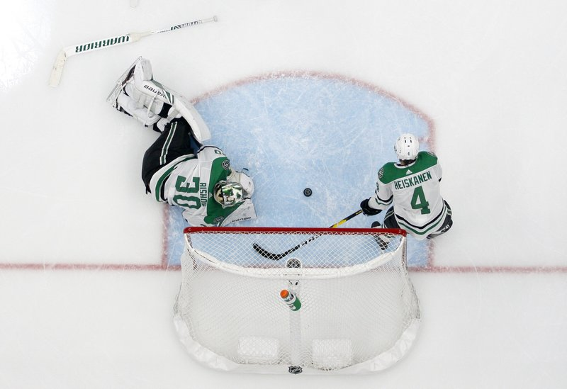 Dallas Stars' Ben Bishop (30) and Miro Heiskanen (4) lie by the net after giving up a score to St. Louis Blues' Pat Maroon during the second overtime in Game 7 of an NHL second-round hockey playoff series Tuesday, May 7, 2019, in St. (AP Photo/Jeff Roberson)