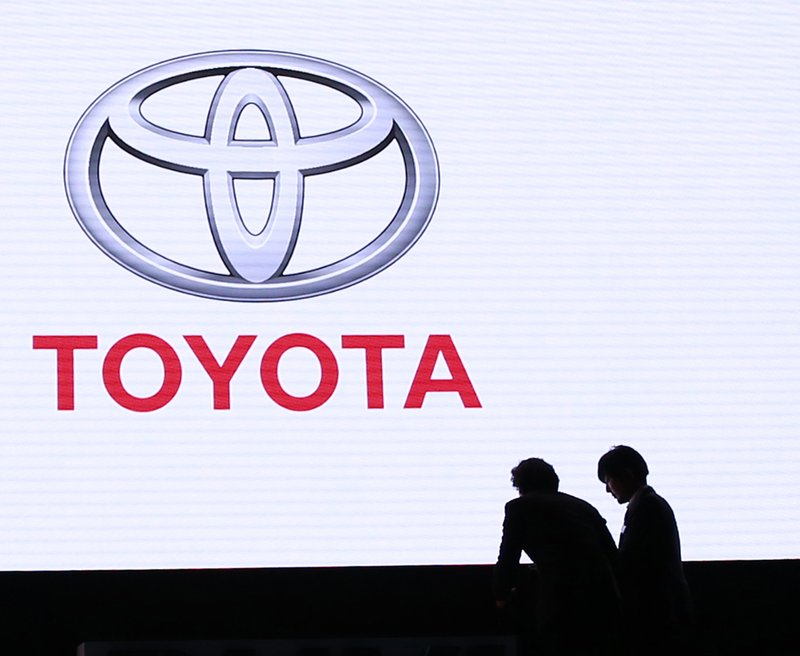 FILE - In this Feb. 15, 2017, file photo, event staff prepares a press conference of Toyota Motor Corp. (AP Photo/Shizuo Kambayashi, File)