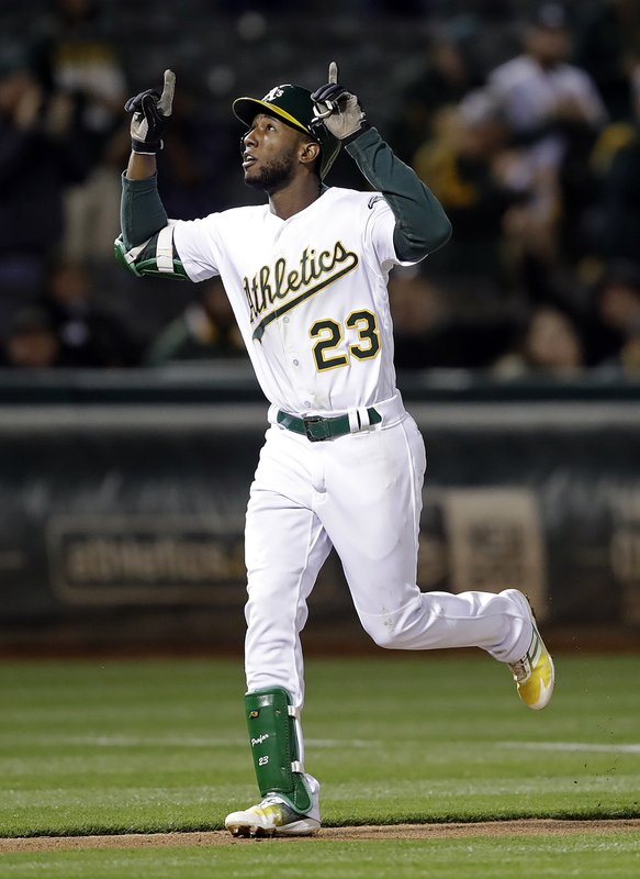 Oakland Athletics' Jurickson Profar celebrates after hitting a home run off Cincinnati Reds' Robert Stephenson during the seventh inning of a baseball game Tuesday, May 7, 2019, in Oakland, Calif. (AP Photo/Ben Margot)