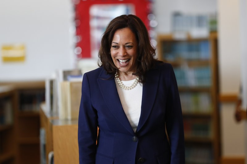 Democratic presidential candidate Sen. Kamala Harris, D-Calif., greets students at Miller Elementary School in Dearborn, Mich. (AP Photo/Paul Sancya)