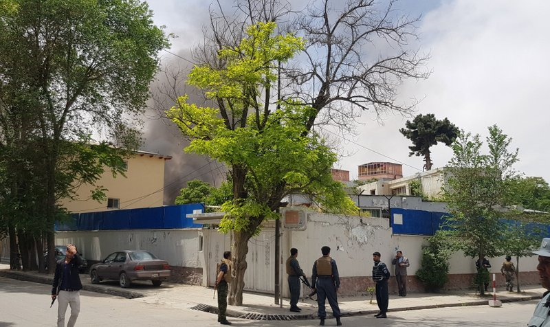 Afghan security personnel watch as smoke rises after a huge explosion near the offices of the attorney general in Kabul, Afghanistan, Wednesday, May 8, 2019. (AP Photo/Rahmat Gul)