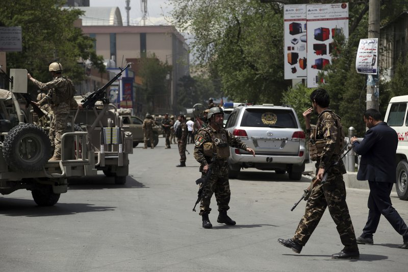 Afghan security personnel arrives near the site of a huge explosion in Kabul, Afghanistan, Wednesday, May 8, 2019. (AP Photo/Rahmat Gul)