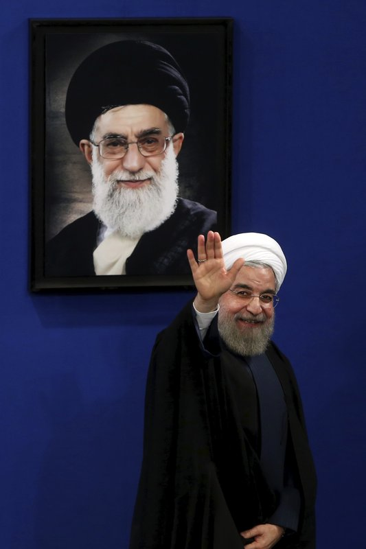 FILE - In this Aug. 29, 2015 file photo, Iran's President Hassan Rouhani waves to reporters at the conclusion of a press conference in Tehran, Iran. (AP Photo/Ebrahim Noroozi, File)