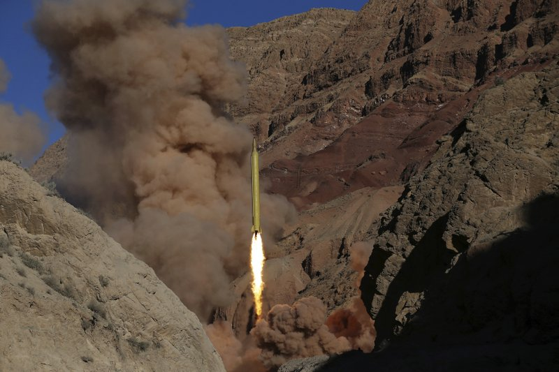 FILE - In this March 9, 2016 file photo obtained from the Iranian Fars News Agency, a Qadr H long-range ballistic surface-to-surface missile is fired by Iran's powerful Revolutionary Guard during a maneuver in an undisclosed location in Iran. (AP Photo/Fars News Agency, Omid Vahabzadeh, File)