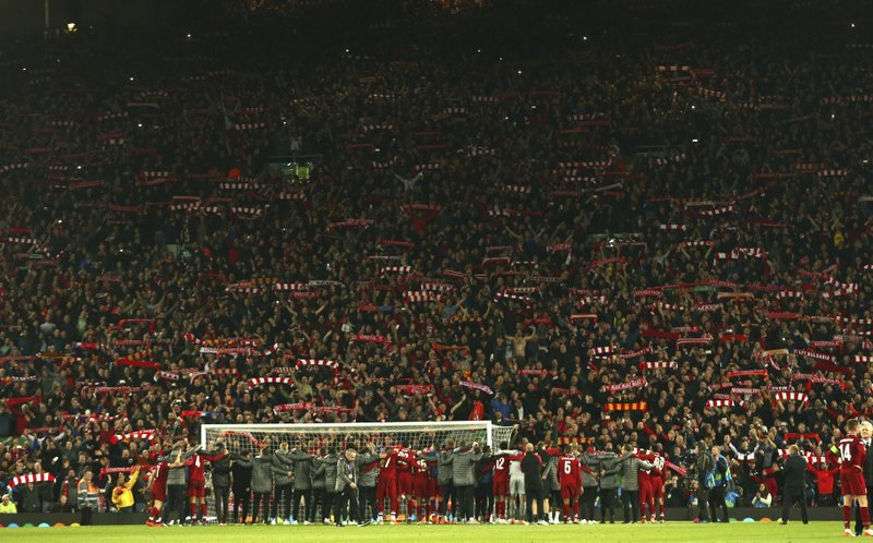 Liverpool players celebrate their victory with supporters after wining the Champions League semifinal, second leg, soccer match between Liverpool and FC Barcelona at the Anfield stadium in Liverpool, England, Tuesday, May 7, 2019. (AP Photo/Dave Thompson)