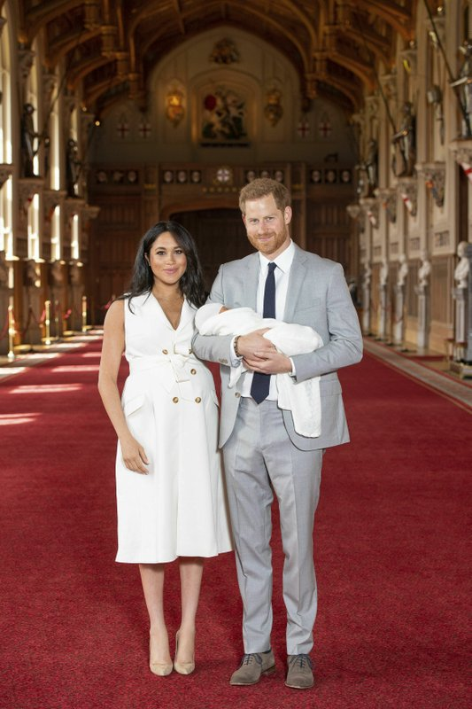 Britain's Prince Harry and Meghan, Duchess of Sussex, during a photocall with their newborn son, in St George's Hall at Windsor Castle, Windsor, south England, Wednesday May 8, 2019. Baby Sussex was born Monday at 5:26 a.m. (0426 GMT; 12:26 a.m. EDT) at an as-yet-undisclosed location. (Dominic Lipinski/Pool via AP)