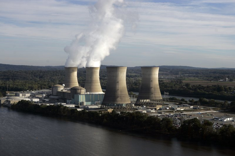 FILE - In this Oct. 19, 2005, file photo, steam billows from two active cooling towers of the Three Mile Island nuclear power plant in Middletown, Pa. (AP Photo/Carolyn Kaster, File)