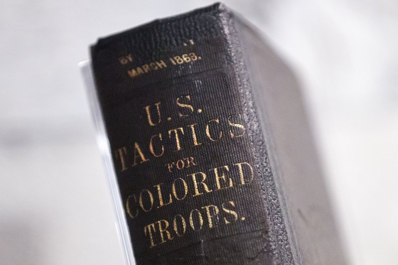 In this Tuesday, May 7, 2019 photo, a 1863 Training Manual For U.S. Colored Troops is displayed in the new exhibit