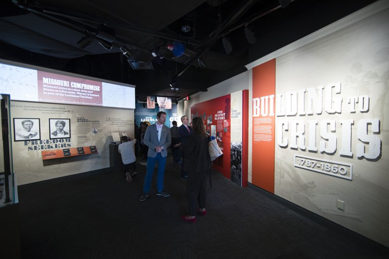 In this Tuesday, May 7, 2019 photo, visitors stroll through the new exhibit