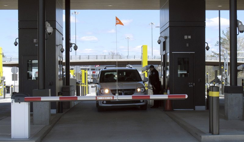 A customs officer stands by a vehicles crossing through the U.S. border post on Wednesday May 8, 2019, at the new border crossing facility on the U. (AP Photo/Wilson Ring)
