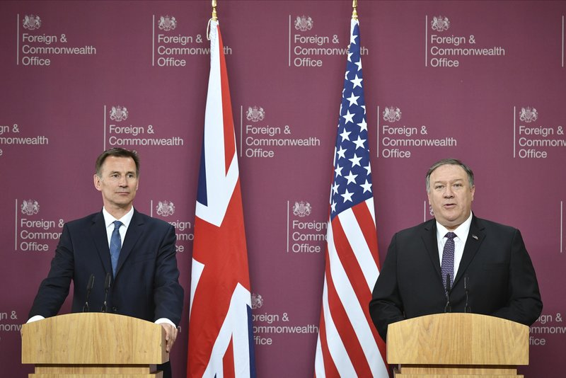 US Secretary of State Mike Pompeo, right, and Britain's Foreign Secretary Jeremy Hunt attend a joint press conference at the Foreign Office in central London, Wednesday May 8, 2019. (Mandel Ngan/Pool via AP)
