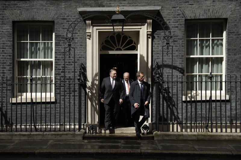 U.S. Secretary of State Mike Pompeo, left, leaves after meeting British Prime Minister Theresa May at 10 Downing Street in London, Wednesday, May 8, 2019. (AP Photo/Matt Dunham)