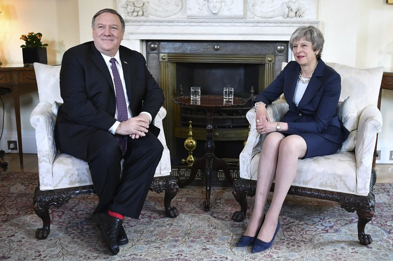 US Secretary of State Mike Pompeo meets with Britain's Prime Minister Theresa May, right, at 10 Downing Street in central London, Wednesday May 8, 2019. (Mandel Ngan/Pool via AP)