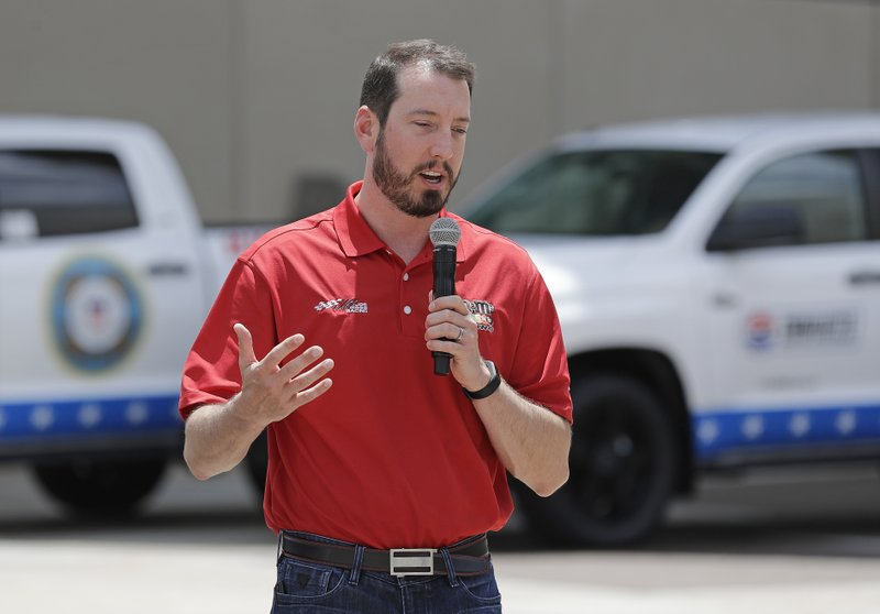 Driver Kyle Busch talks about defending his title in the Coca-Cola 600 NASCAR Cup series auto race during a news conference in Charlotte, N. (AP Photo/Chuck Burton)