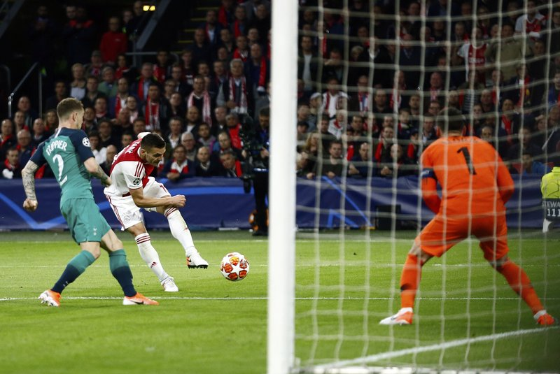 Ajax's Dusan Tadic, 2nd left, attempts a shot at goal during the Champions League semifinal second leg soccer match between Ajax and Tottenham Hotspur at the Johan Cruyff ArenA in Amsterdam, Netherlands, Wednesday, May 8, 2019. (AP Photo/Peter Dejong)