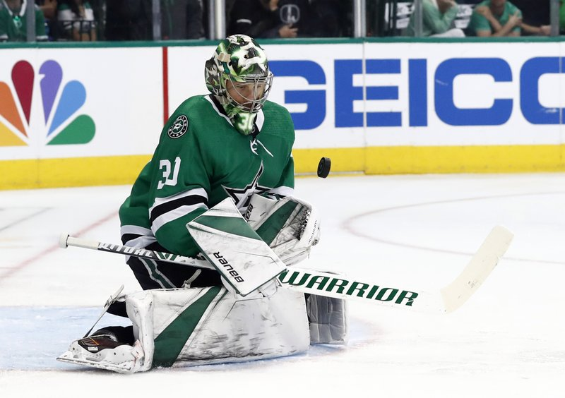 Dallas Stars goaltender Ben Bishop stops a puck during the second period in Game 6 of an NHL second-round hockey playoff series against the St. (AP Photo/Tony Gutierrez)
