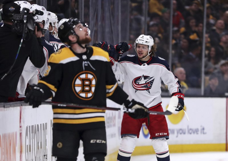Columbus Blue Jackets left wing Artemi Panarin, right, is congratulated by teammates after his goal during the second period of Game 2 of an NHL hockey second-round playoff series against the Boston Bruins, Saturday, April 27, 2019, in Boston. (AP Photo/Charles Krupa)