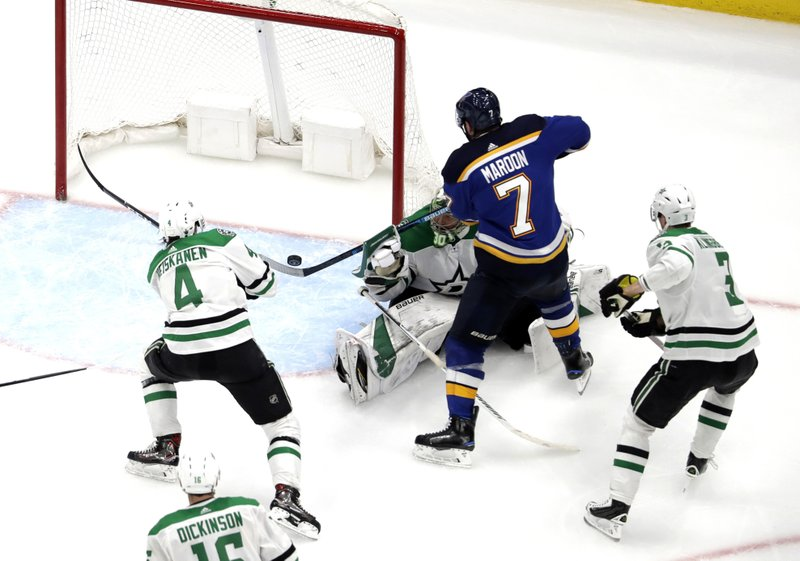 St. Louis Blues' Pat Maroon (7) scores the game-winning goal past Dallas Stars goaltender Ben Bishop, as Miro Heiskanen (4) and John Klingberg (3) help defend during the second overtime in Game 7 of an NHL second-round hockey playoff series Tuesday, May 7, 2019, in St. (AP Photo/Jeff Roberson)