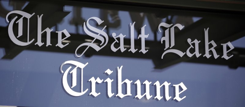 In this April 20, 2016, file photo, shows the Salt Lake Tribune sign in Salt Lake City. The Salt Lake Tribune has announced plans to become a nonprofit as it moves toward a nontraditional model that it hopes will ensure long term stability after years of financial struggles. (AP Photo/Rick Bowmer, File)