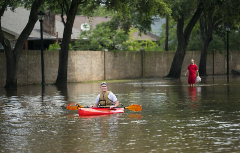 Kurt Rowland surveys the scene at the intersection of Austin Parkway and Sweetwater Blvd. in the Colony Bend neighborhood of Sugar Land, Texas, on Wednesday, May 8, 2019. (Mark Mulligan/Houston Chronicle via AP)