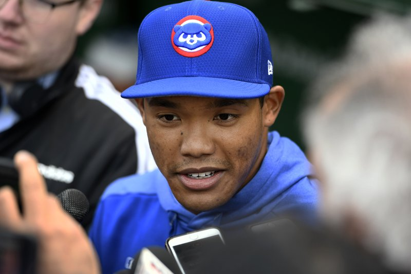 Chicago Cubs shortstop Addison Russell speaks to the media in the dugout before a baseball game against the Miami Marlins, Wednesday, May 8, 2019, in Chicago. (AP Photo/Paul Beaty)