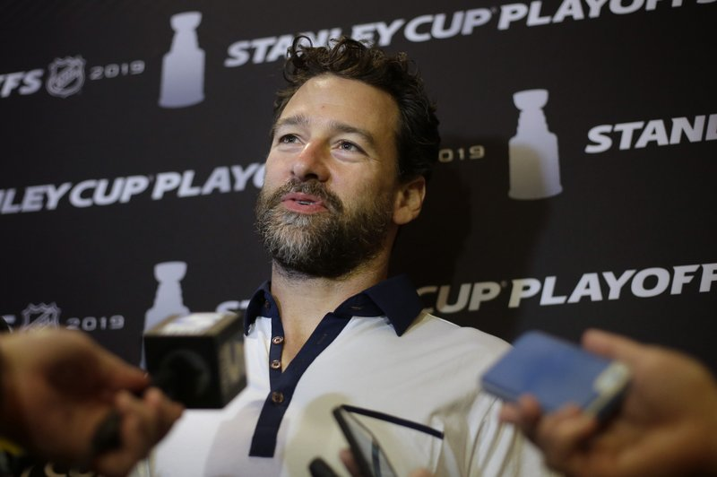 Carolina Hurricanes' Justin Williams faces reporters during a media availability Wednesday, May 8, 2019, in Boston, in advance of Thursday's Game 1 of the NHL hockey Stanley Cup Eastern Conference finals against the Boston Bruins. (AP Photo/Steven Senne)