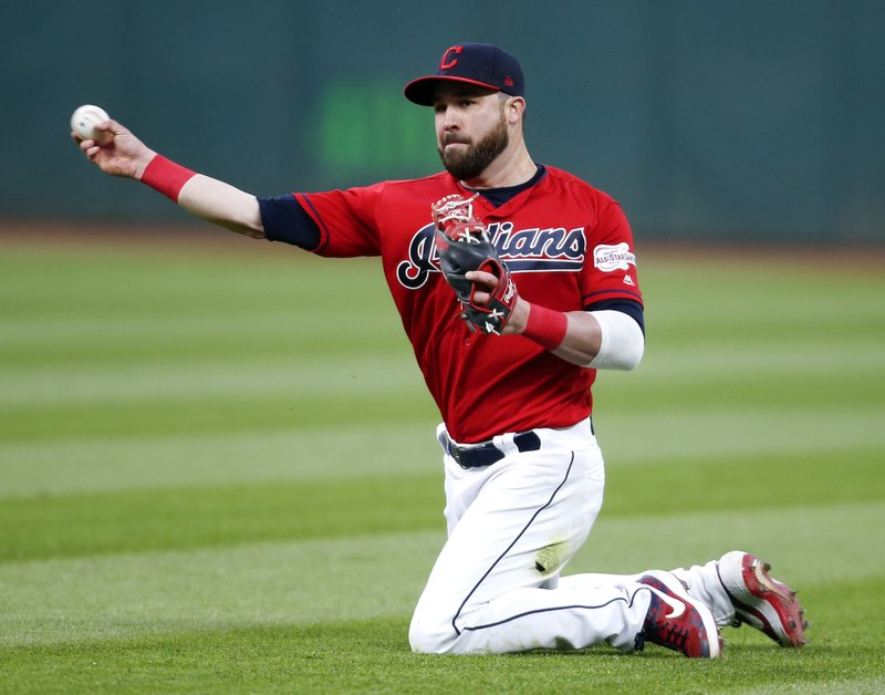 Cleveland Indians' Jason Kipnis throws out Chicago White Sox's Yonder Alonso at first base during the eighth inning of a baseball game Wednesday, May 8, 2019, in Cleveland. (AP Photo/Ron Schwane)