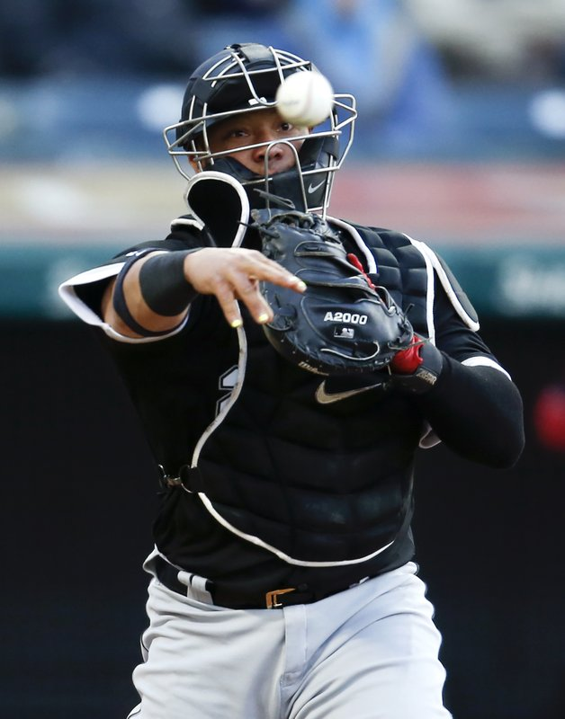 Chicago White Sox's Welington Castillo throws out Cleveland Indians' Jose Ramirez at first base during the fifth inning of a baseball game Wednesday, May 8, 2019, in Cleveland. (AP Photo/Ron Schwane)