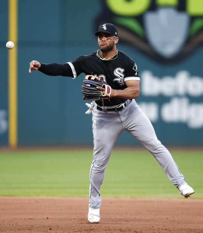 Chicago White Sox's Yoan Moncada throws out Cleveland Indians' Jason Kipnis at first base during the seventh inning of a baseball game Wednesday, May 8, 2019, in Cleveland. (AP Photo/Ron Schwane)